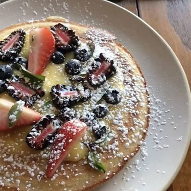 Semolina pancake, lemon curd, blueberries, basil, maple syrup at Rubirosa
