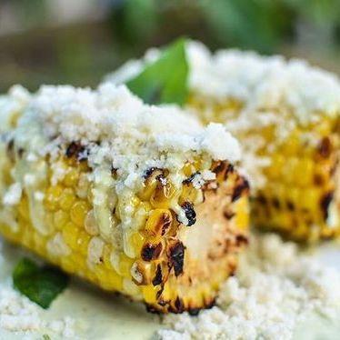 Texas corn on the cob, basil, aioli and parmesan at Coltivare Pizza & Garden