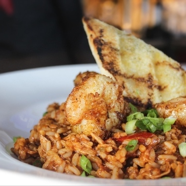Jambalaya with chicken, tasso, andouille, and shrimp. at Roux