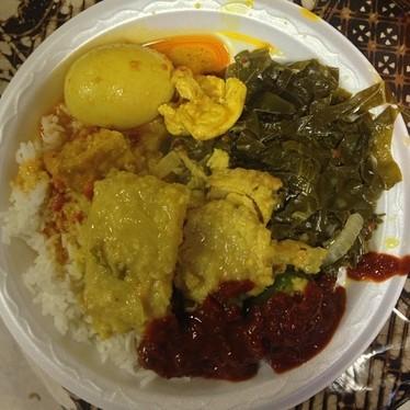Fish, collard greens, and eggs at Hardena Waroeng Surabaya Restaurant