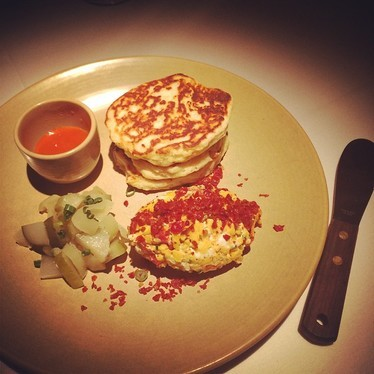 Pancakes with pimientos and pickles at Stars Rooftop & Grill Room