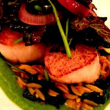 Seasonal scallop special, onions, greens at Rubirosa