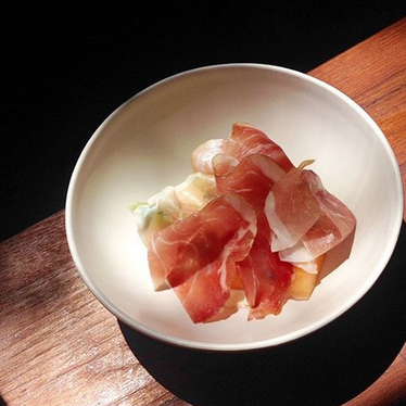 Chilled cantaloupe and dry-cured ham at The Four Horsemen