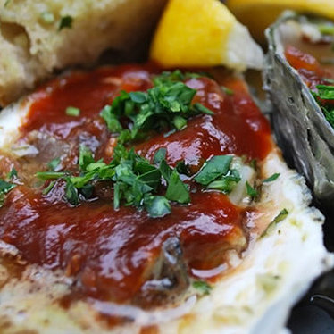 BBQ oysters with garlic butter at The Marshall Store