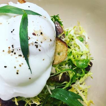 Salad Lyonnaise with ramp vinegar, poached egg, duck confit at The Restaurant at Cannon Green