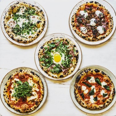 Pizzas with egg, mozzarella, arugula and herbs at FIG Santa Monica