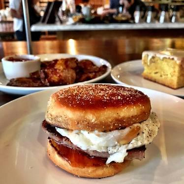 Sausage & egg English muffin with foie gras butter & quince jam at The Purple Pig