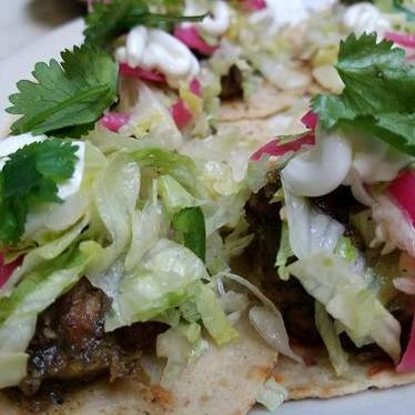 Tacos of the day with radish, cabbage, cilantro and crema at Brave Horse Tavern