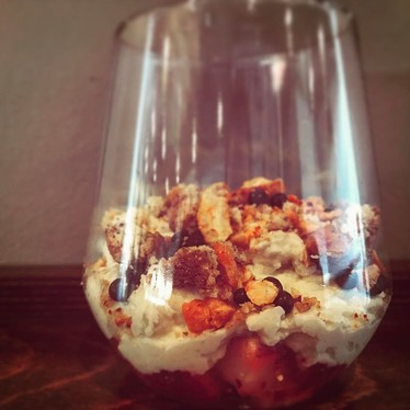 Korean chili flake macerated strawberries, banana cream, crumble, chocolate and candied cashews at Mandu