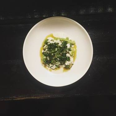 Local stracciatella with broccoli floret salsa verde and grilled stems at Eating House