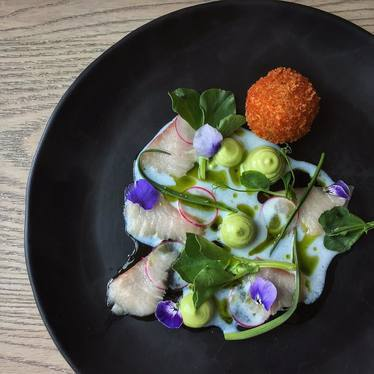 Hamachi crudo, brandade, buttermilk, wild garlic mayonnaise, fava tips and sea grass at Juniper