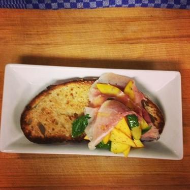 Tartine with ham, basil, honey, and peach at 5&10