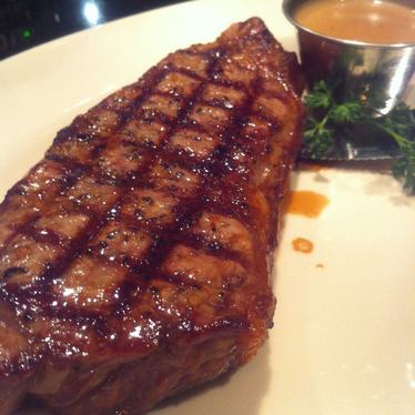 New York steak with peppercorn sauce at Sundance The Steakhouse