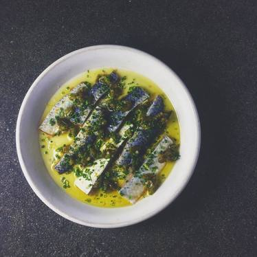 Herring pickled with boquerones, poblano, chives at The Four Horsemen