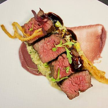 Prime beef spinalis, red onion jam, barley risotto, tempura ramps at Deuxave