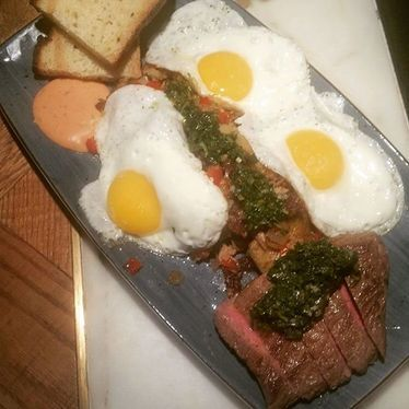 Three eggs, duck, potato hash, flank, chimichurri, forno toast and chipotle mayo at Baro