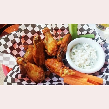 Chicken wings with hot sauce and feta tzatziki at Vesper Lounge