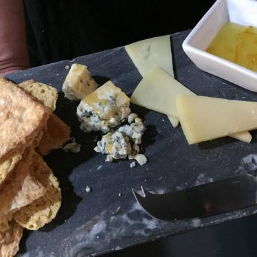 Cheese slate with toast and preserves at The Treasury