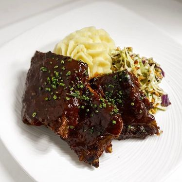 Baby back pork ribs, citrus BBQ sauce, slaw, butter whipped potatoes at Hali'imaile General Store