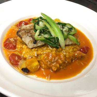 Cod with tomato, lime, risotto, coconut, and bok choy at Ortanique on the Mile