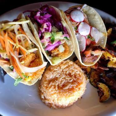 Fried shrimp, Baja fish and carné asada tacos at Araña Taqueria Y Cantina