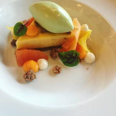 Orange cremeux with feuilletine, carrot, and sorrel ice cream at Beast