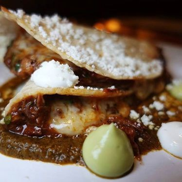 Oxtail quesadilla with plantain, habanero and salsa quemada at Broken Spanish