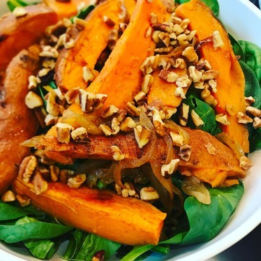 Salad with roasted sweet potato, spinach, caramelized onions, pecans and maple bacon vinaigrette at Catalyst Restaurant