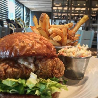 Fried fish sandwich with slaw and fries at Island Creek Oyster Bar