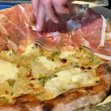 Prosciutto di San Daniele on spring onion pizza at Ken's Artisan Pizza