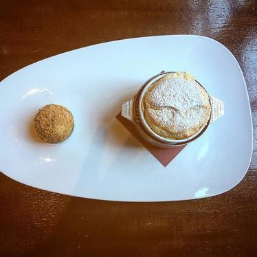 Cushaw soufflé, Speculoos Cookie Butter, cinnamon ice cream, and Speculoos crumbs at Restaurant R'evolution