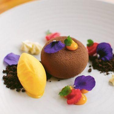 Salted chocolate pot de creme, 64% chocolate mousse, chocolate soil, mango puffs, mango sorbet at Chambar