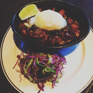 Si Sig; pork belly & ear, soy, soft-cooked egg, rice. at Black Cat
