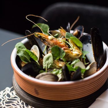 Mussels, prawns and watercress greens at Ortzi