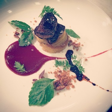 Johnny cakes with foie gras, cherry preserves, pecan crumble, and peppercorn gastrique at Oak Steakhouse