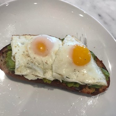 Sourdough toast with avocado and eggs at Kingside