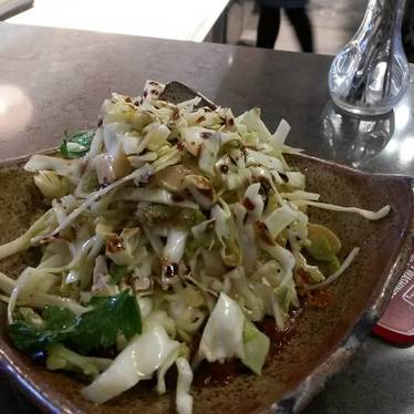 Cabbage salad with olive relish, date chili paste,  almonds and pomegranate at Butcher & Bee