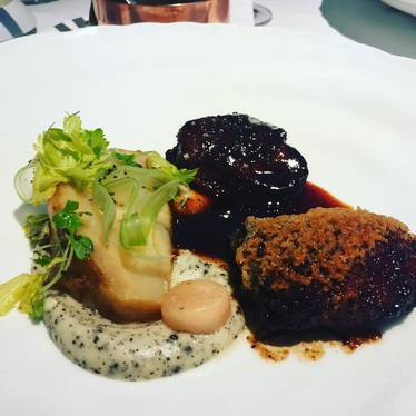 Braised veal cheeks with salt-roasted celeriac, vinoise and truffle celery-root puree at The Modern