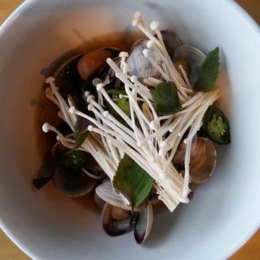 Clams, garlic confit, and mushrooms at Ma'ono Fried Chicken & Whisky