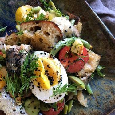 Panzanella, pickled eggs, sardines, nigella seed, and dill  at Outerlands