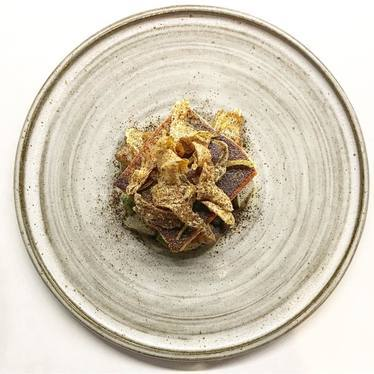 Artichoke, caramelized allium, refried turtle beans, and oro blanco  at Aster