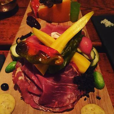 Charcuterie with cheese, pickles, mustard, cucamelon, olives and shishito peppers at 20byNine
