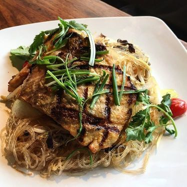 Grilled yellow tail, glass noodles, mushrooms, and tomatoes   at Malai Thai Vietnamese Kitchen & Bar