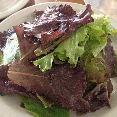 Mixed greens with balsamic vinaigrette at Nomad Pizza