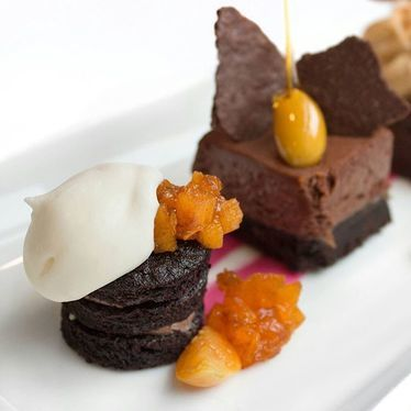 Chocolate cake, buttercream icing, almond toffee, and white chocolate ganache at George Restaurant