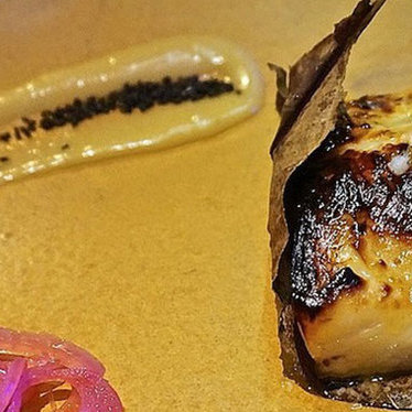 Yuzu marinated black cod in Japanese Magnolia leaf at Roka Akor