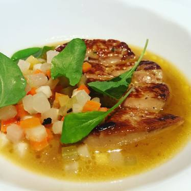 Beautiful seared and pickled foie gras with consommé and pickled root-vegetable Brunoise at The Modern