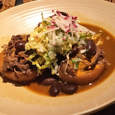 Birria sopes at Frontera Grill