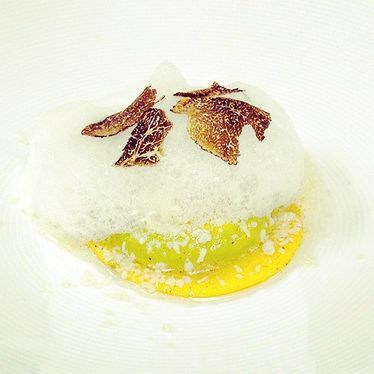 Egg Ravioli, olive oil foam, black summer truffle at Drago Centro