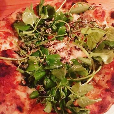 Pizza with greens at Lovely's Fifty Fifty